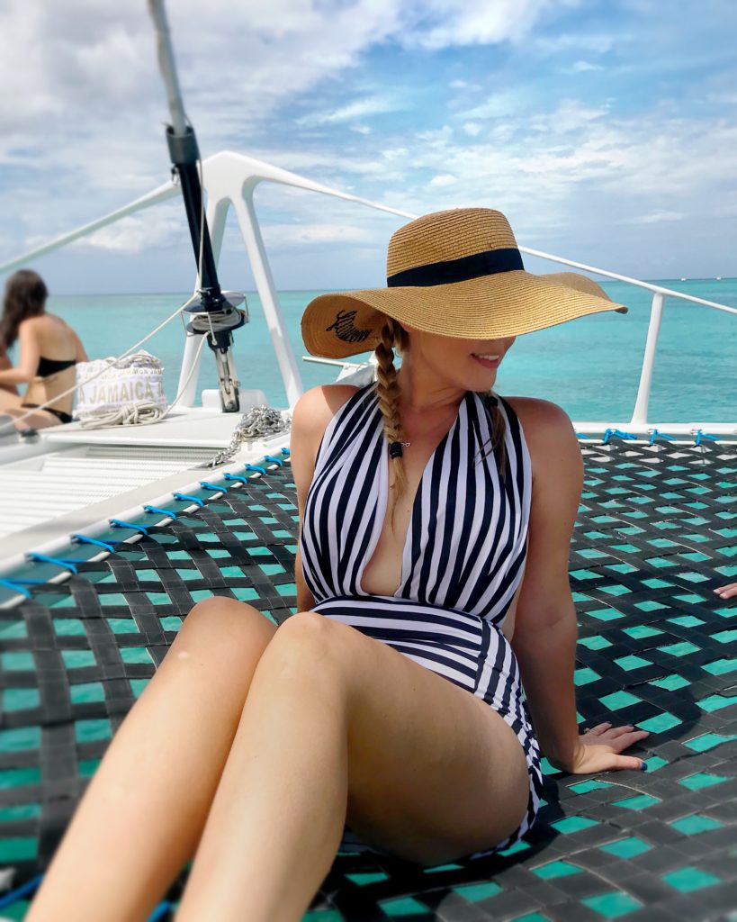 Flattering one piece swimsuit with vertical stripes